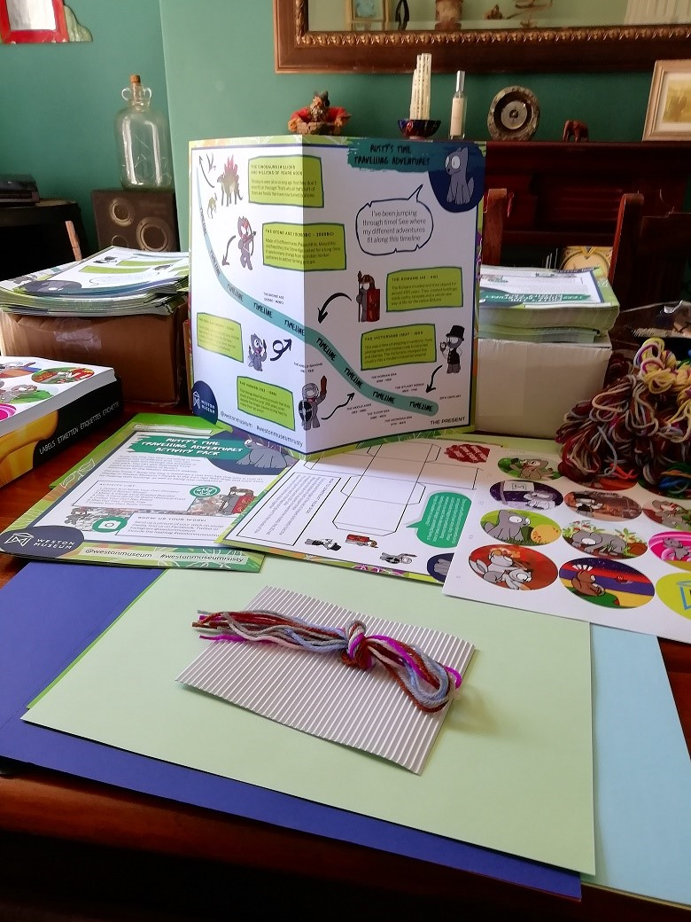 Printed materials and wool for craft packs