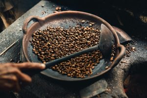 Coffee beans in a round wok.