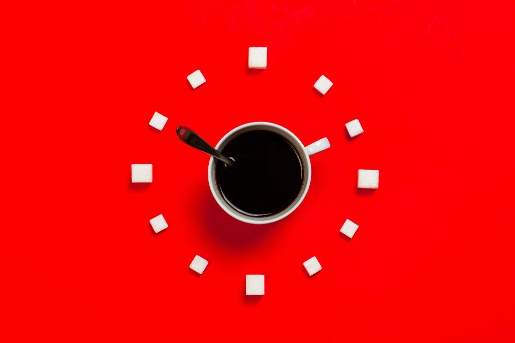 White mug on red background (image courtesy of Stas Knop)