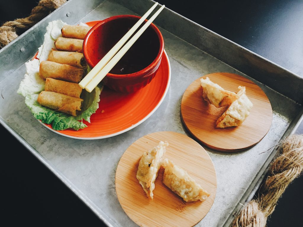 Fried spring rolls and dumplings on a tray (image courtesy of Abby Kihano)