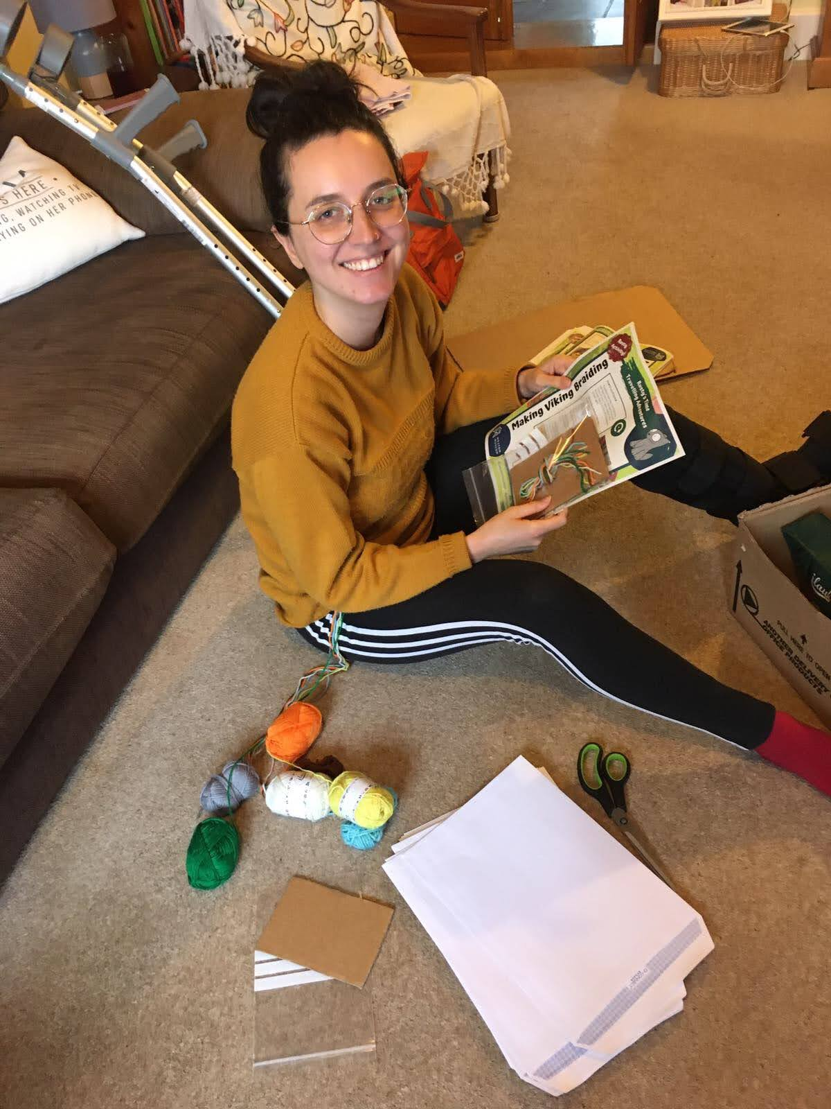 Michaela assembling craft packs